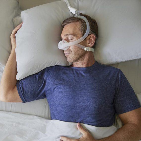 Man-Sleeping-Philips-Respironics-DreamWisp-Nasal-CPAP-Mask_600x600_crop_center@2x